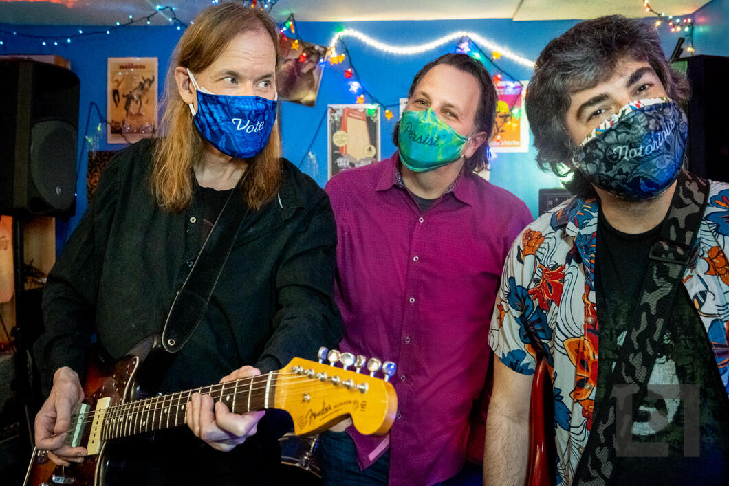 Portrait of rock band TELL wearing The Vote Mask