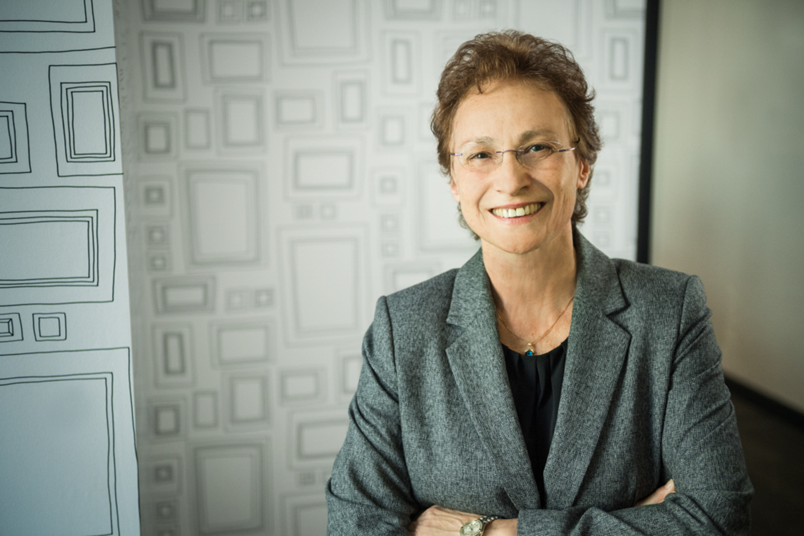 Business woman smiling in front of creative background