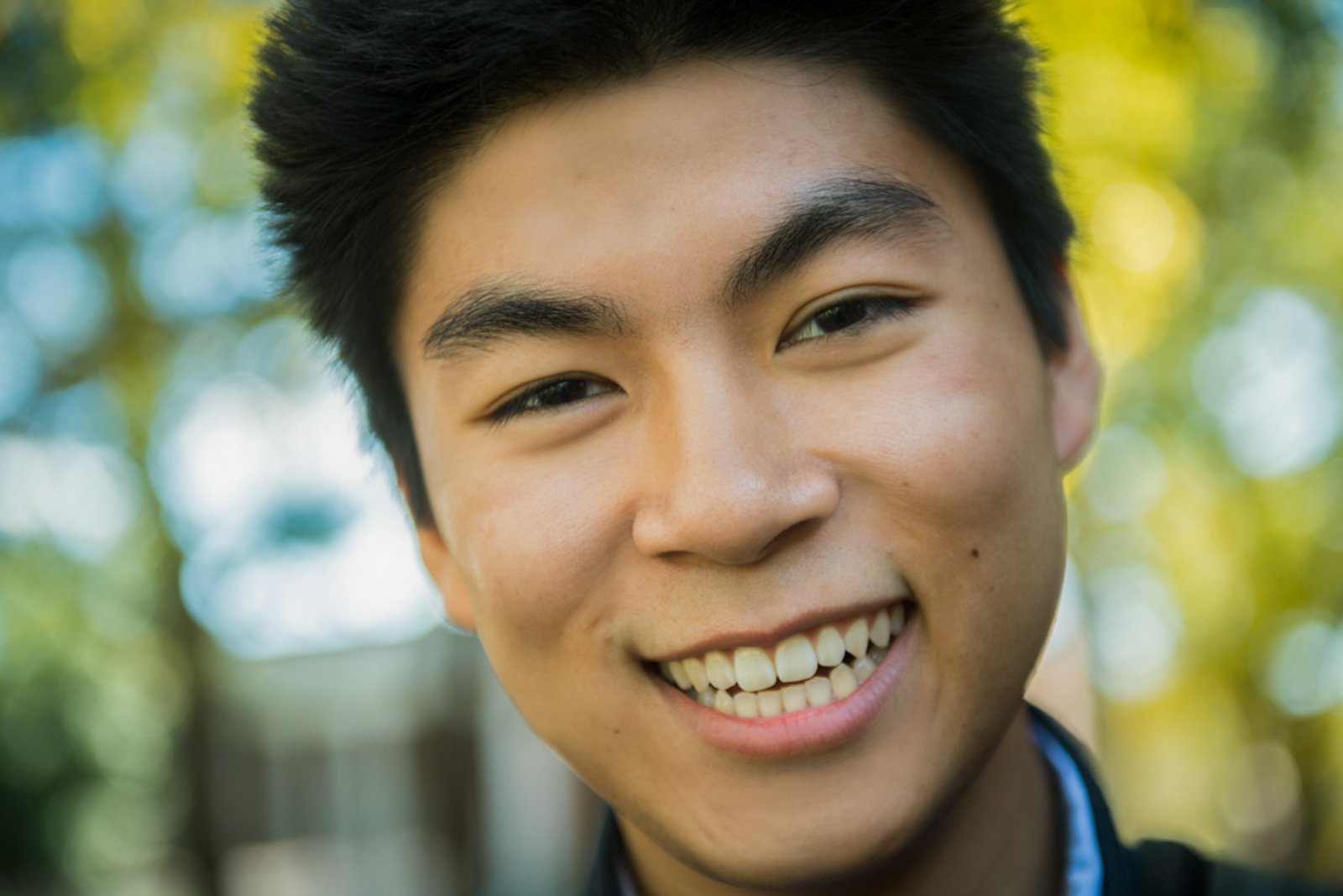 Close up of male student with a wide smile