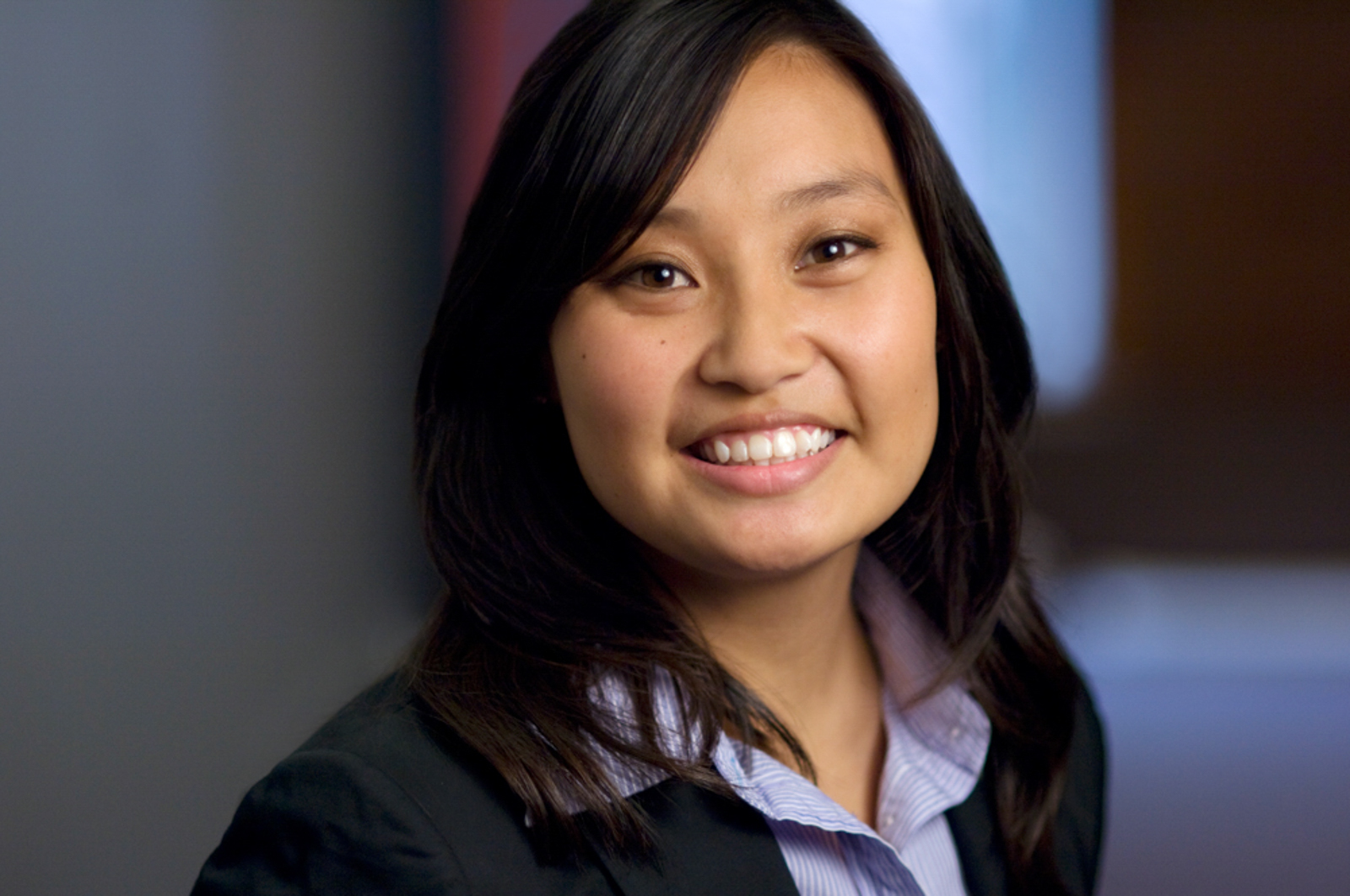 Portrait of young woman smiling in office setup