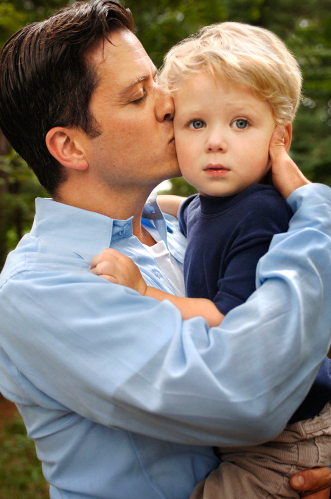 Portrait of man holding a small child, lovingly