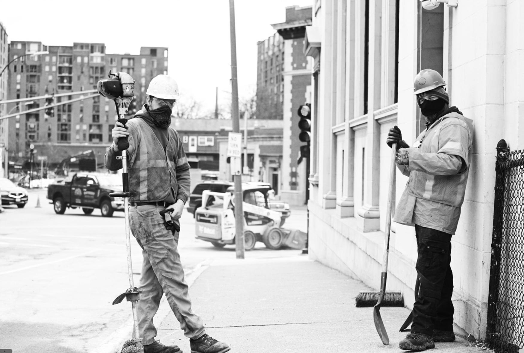 utility workers on sidewalk