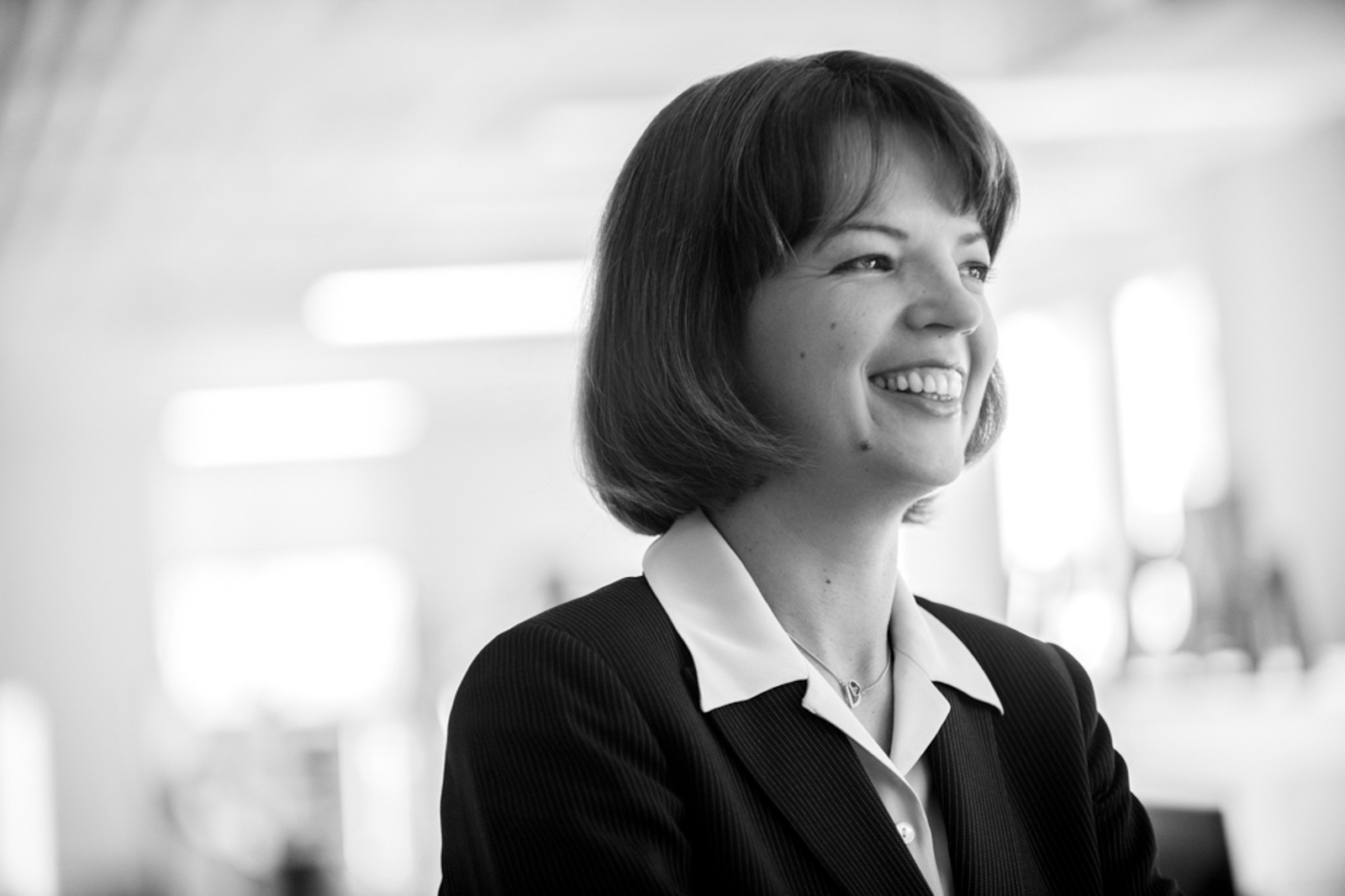 Black and White portrait of business woman, smiling confidently