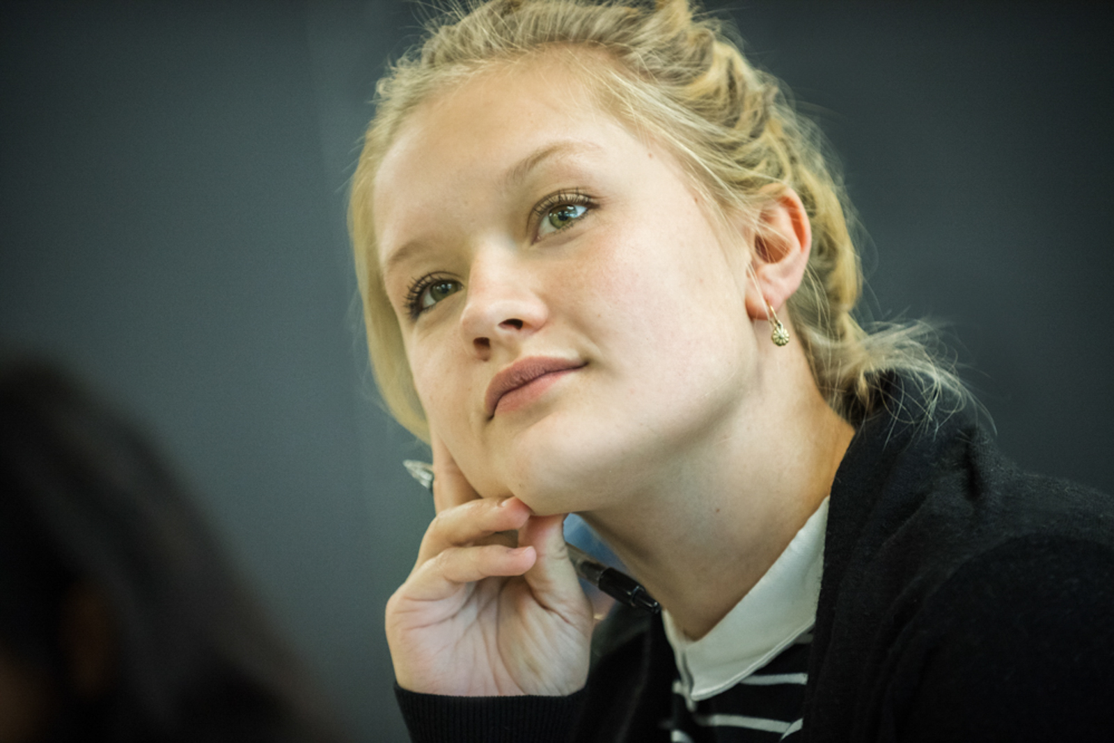 Young student in class paying close attention
