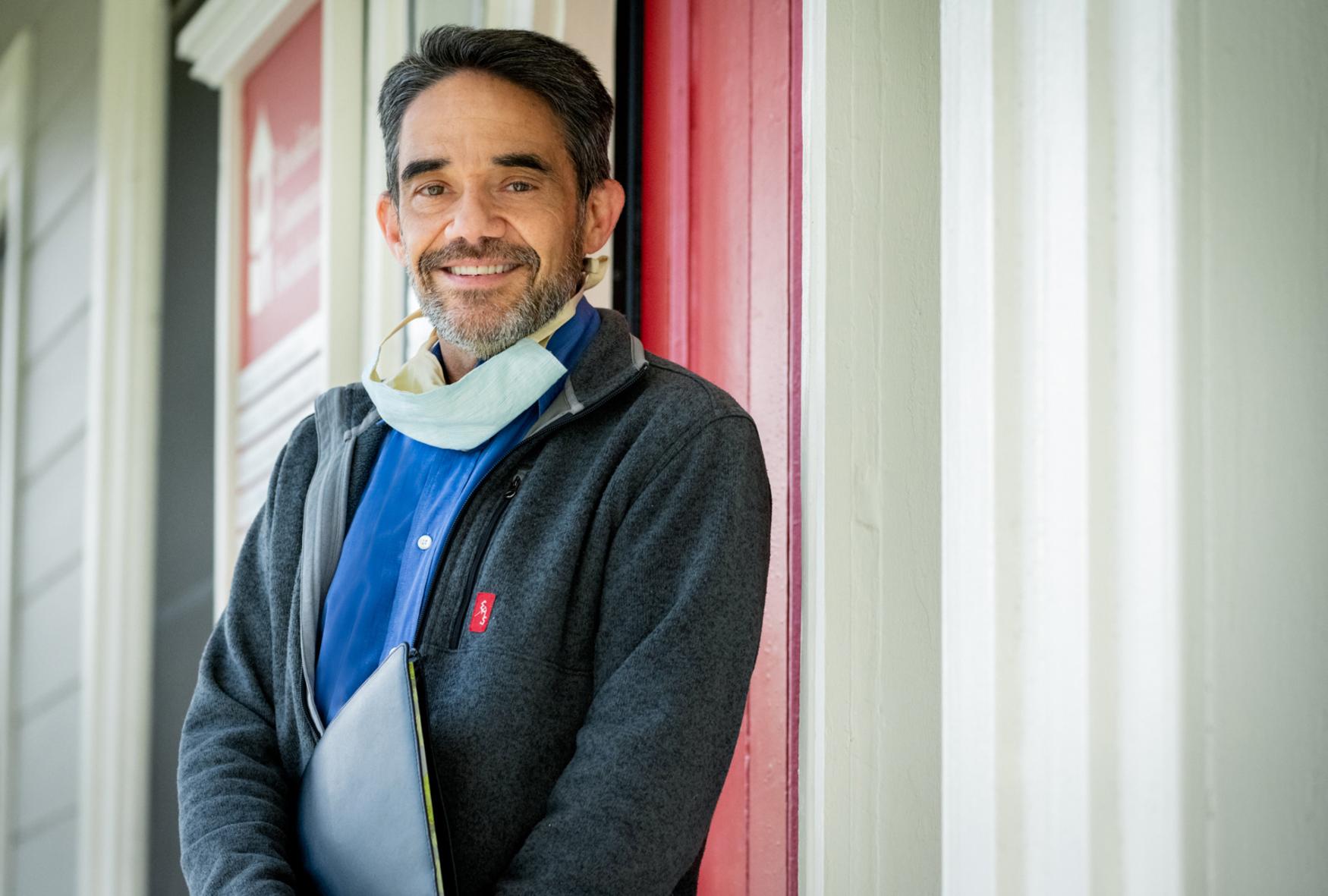 portrait of a man outside house office