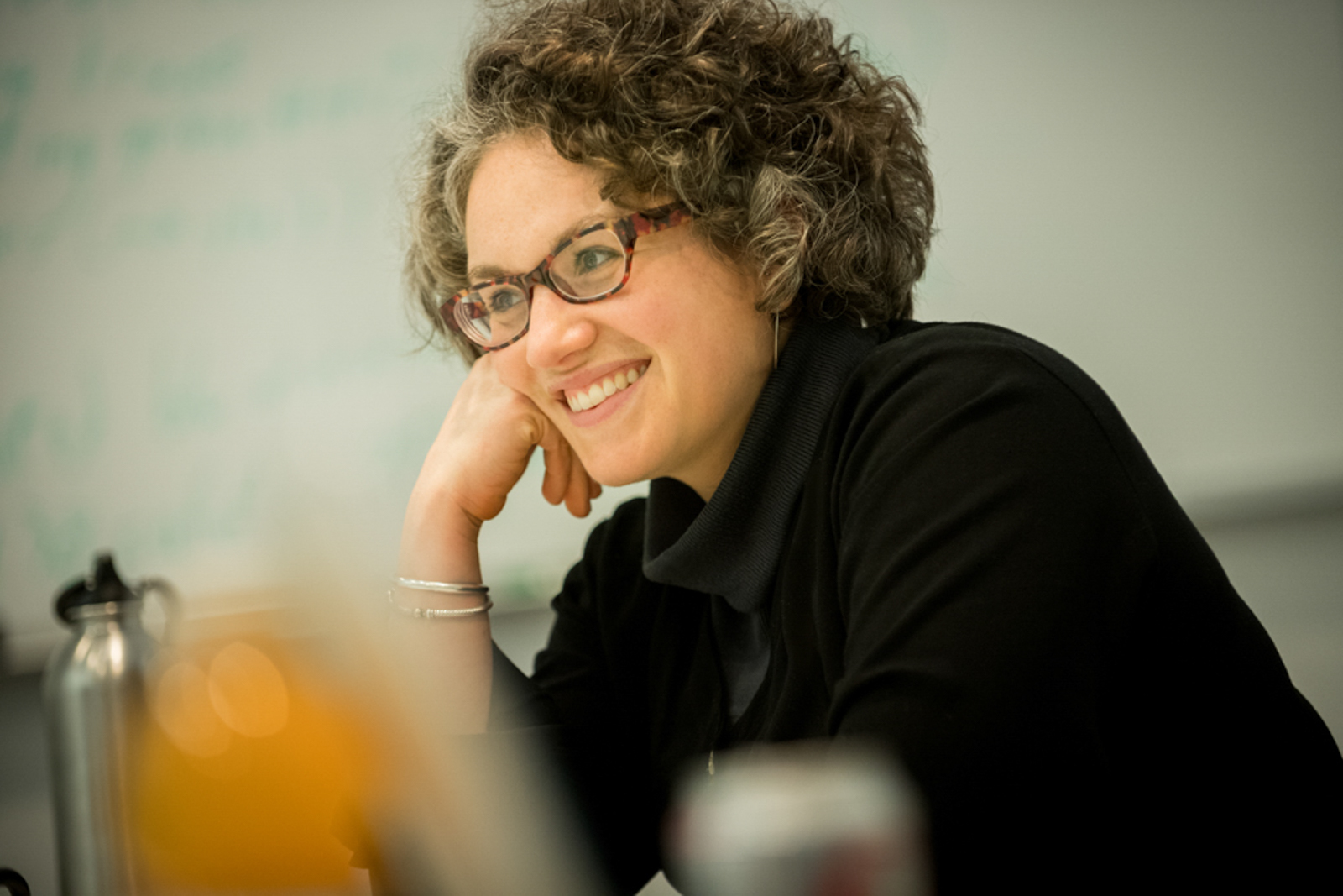 Candid of woman smiling during a meeting