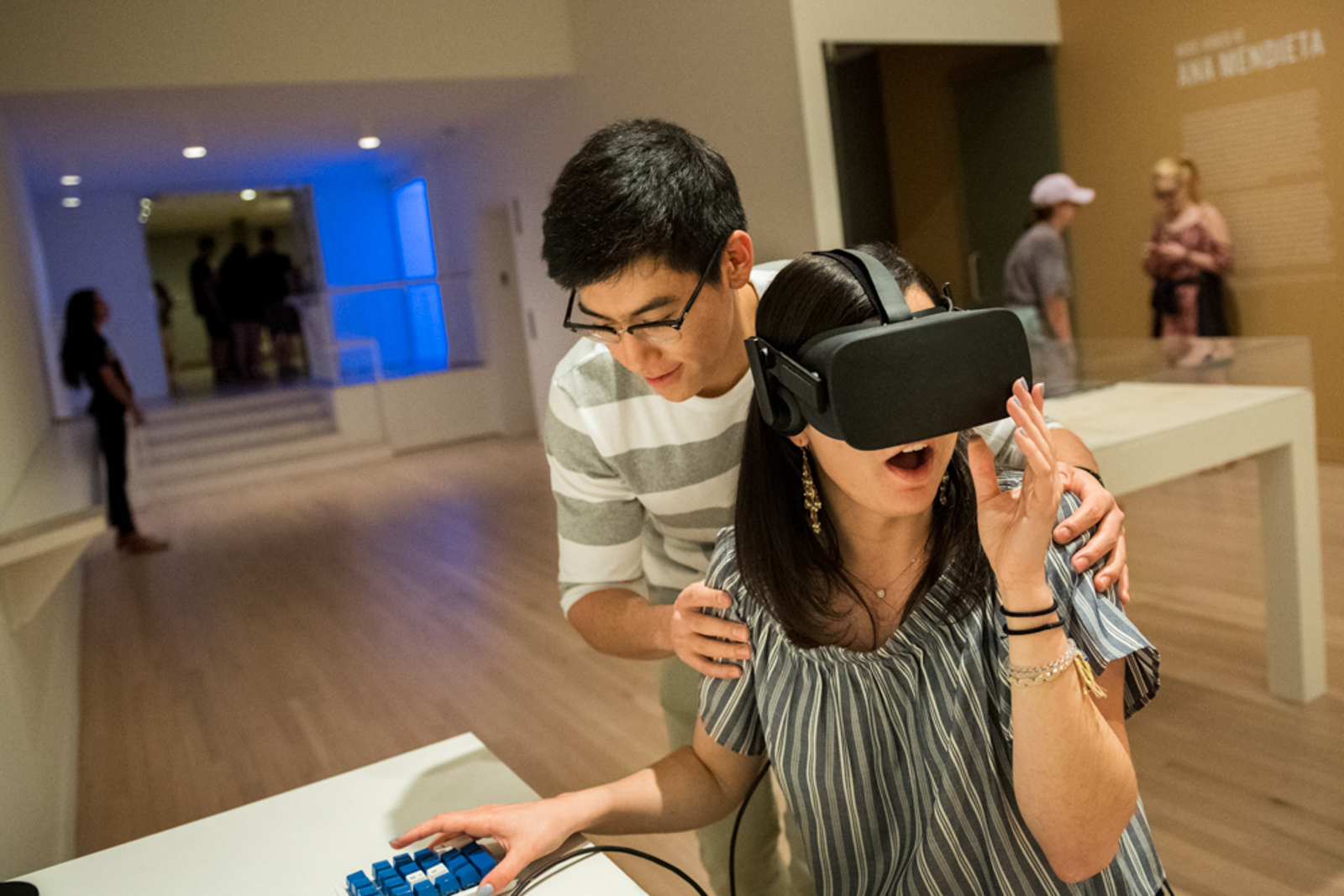 Shot of two students, one of them is trying on virtual reality glasses