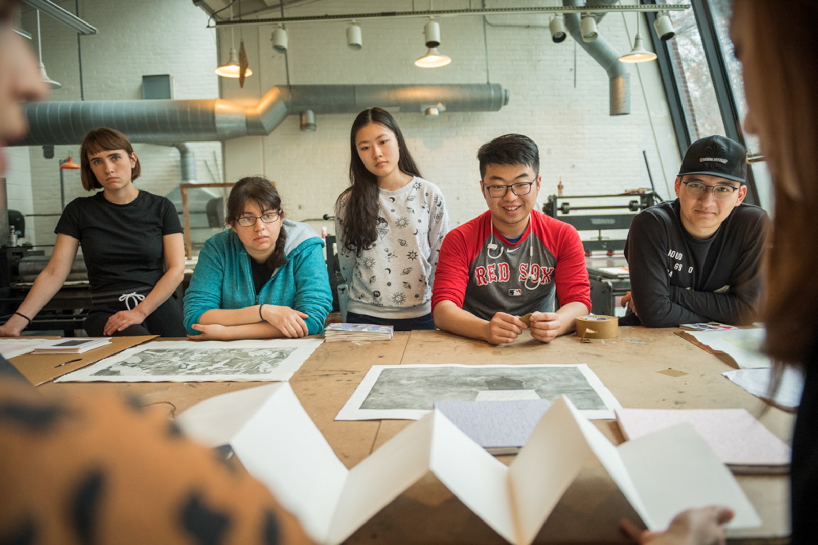 Group of students in art studio seen over the instructor's shoulder
