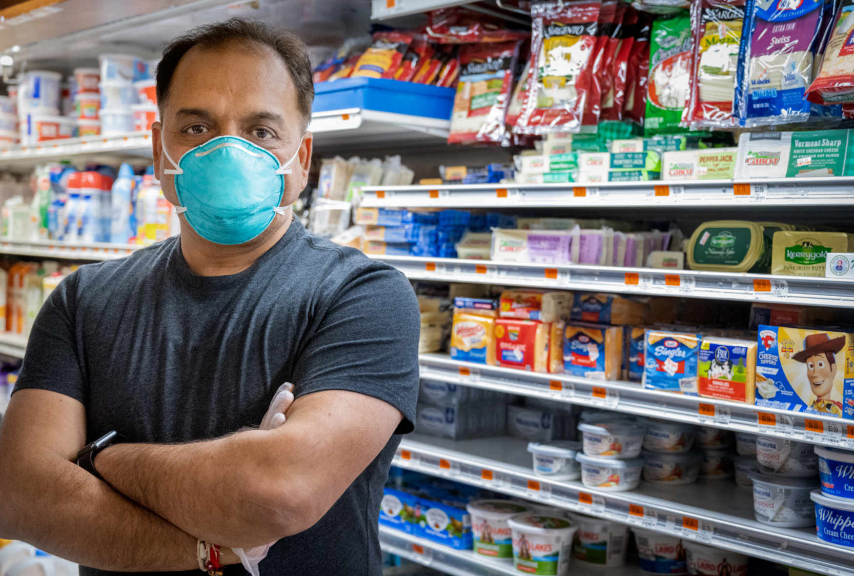 shopkeeper portrait with mask in dary section