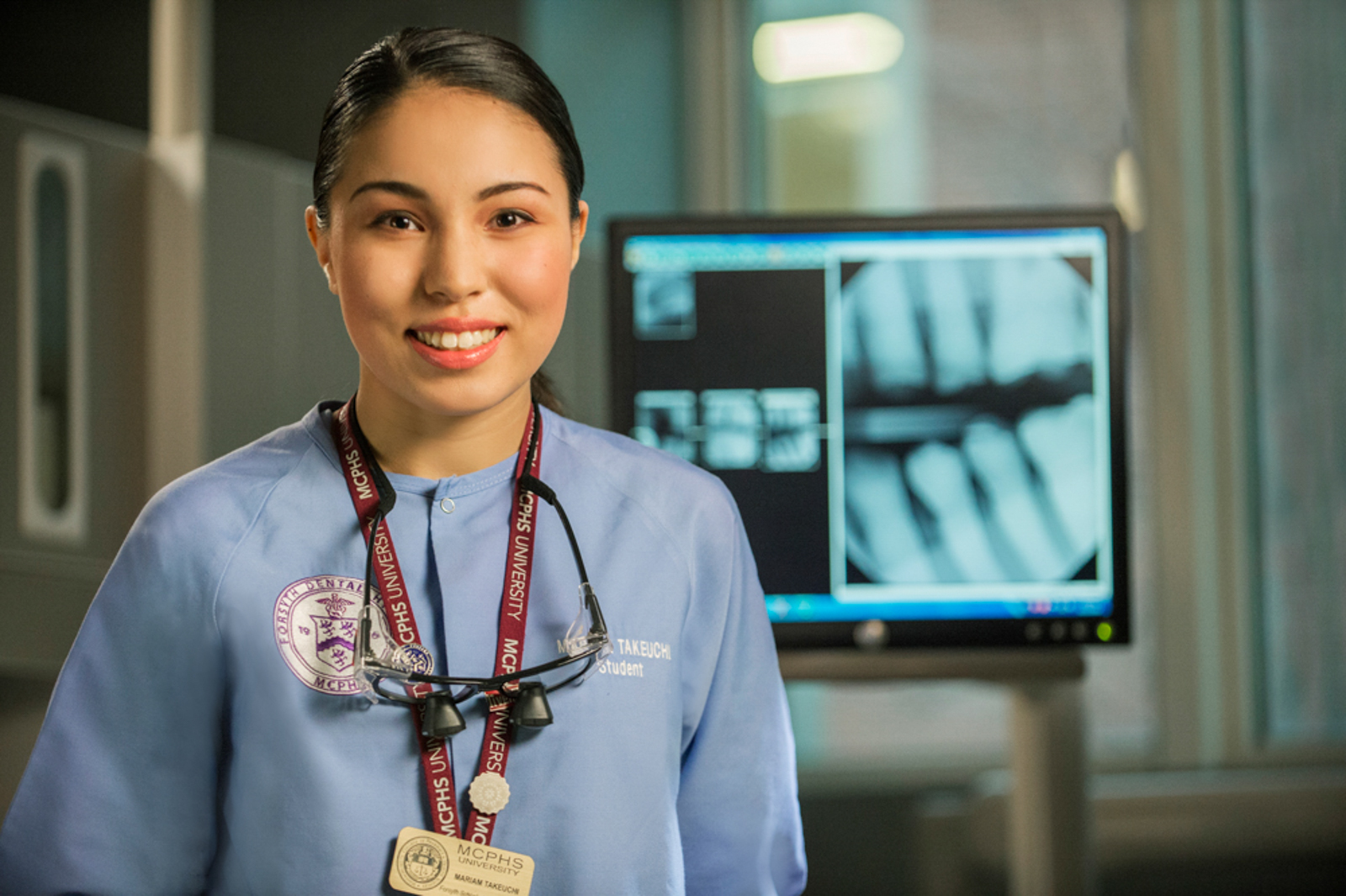 Portrait of female medical student in front of monitor with x-rays