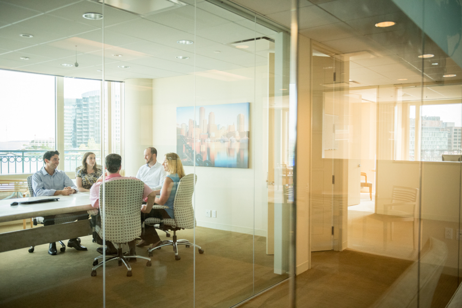 Image of an office meeting seen through a window
