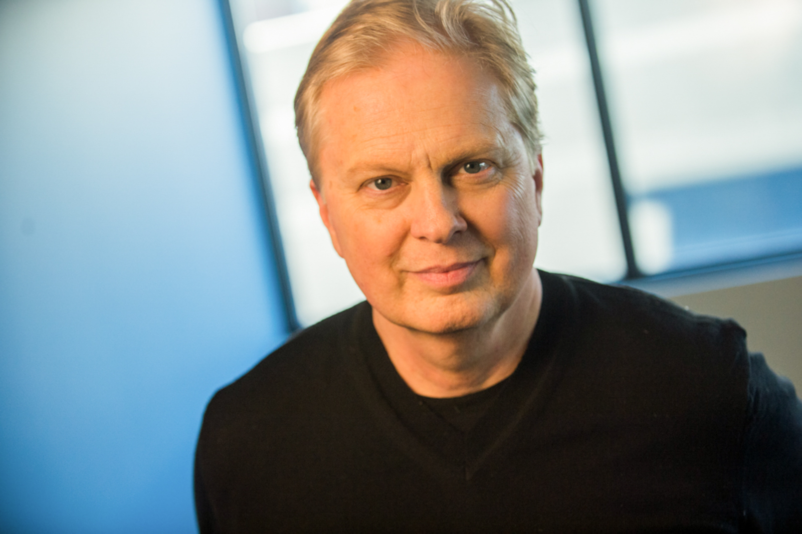 Portrait of journalist Tom Ashbrook with serious expression