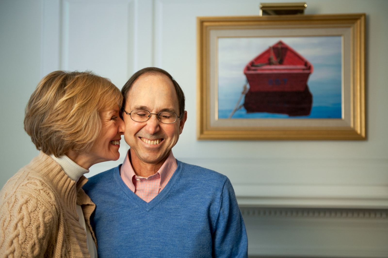 Portrait of smiling couple in a loving moment, with painting