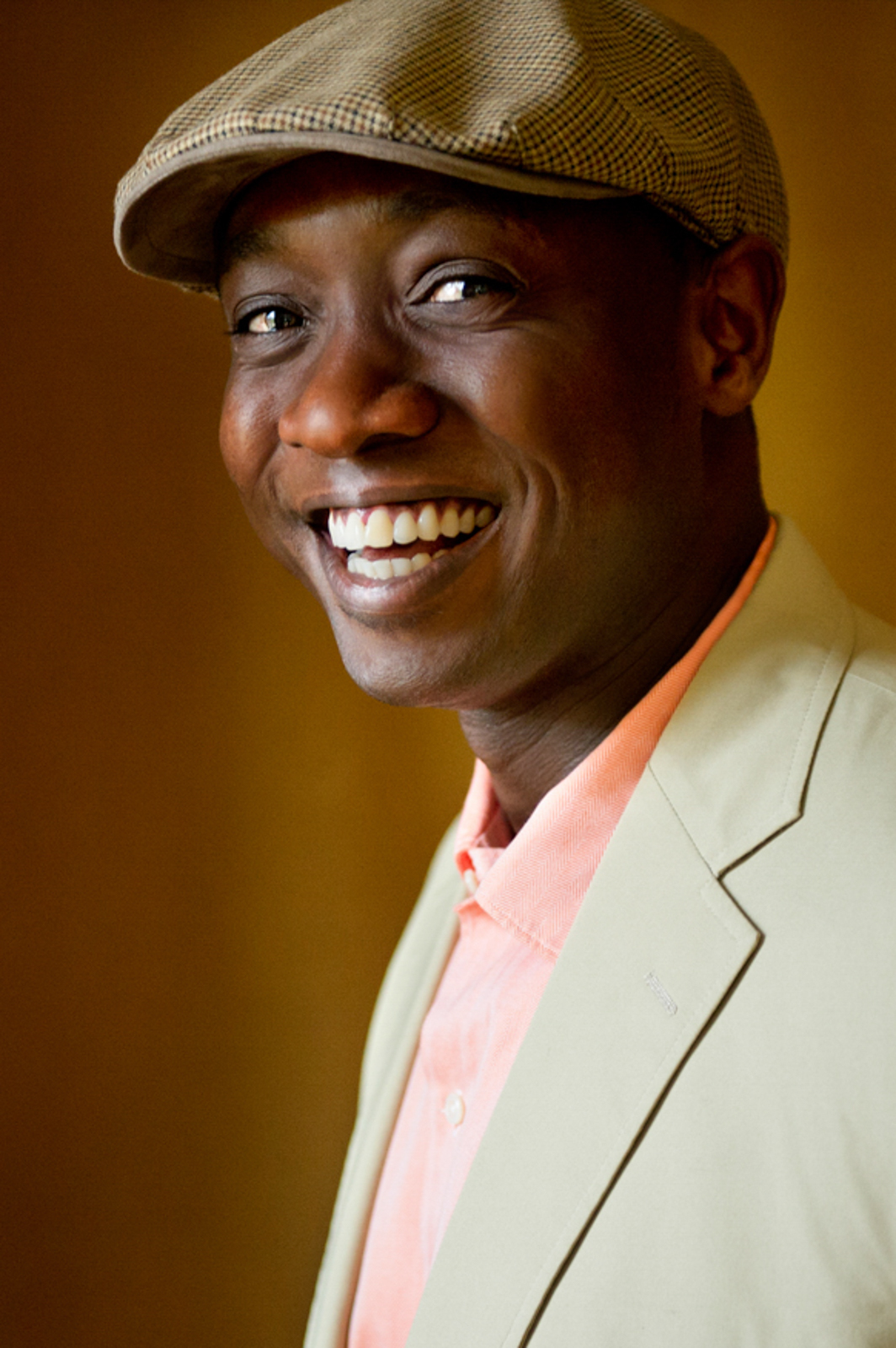 Portrait of man smiling wearing a hat